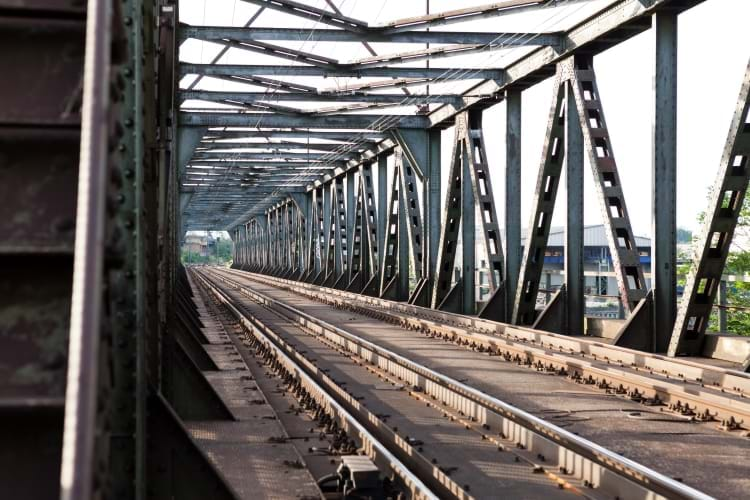 A metal truss engineered railroad bridge with two tracks