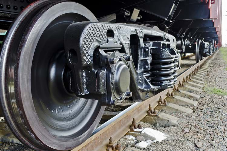 A close-up view of wheels of a freight train