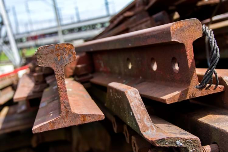 A pile of old rail track pieces
