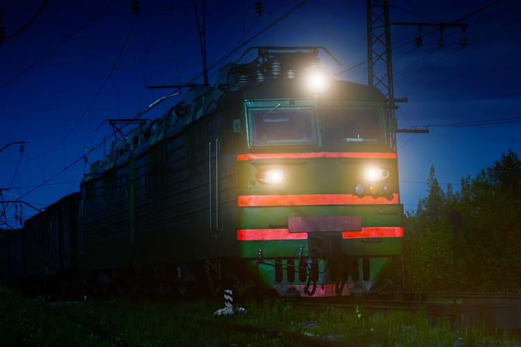 A locomotive with reflective tapes traveling at night