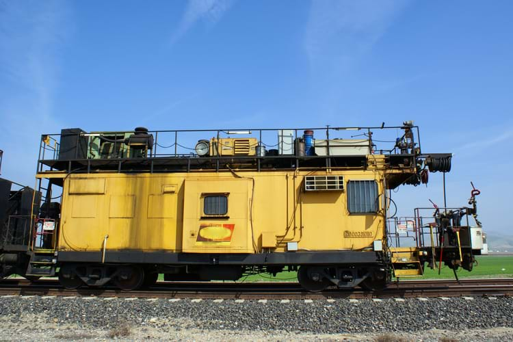 The caboose of a track grinding train which grinds rails to provide longer service life