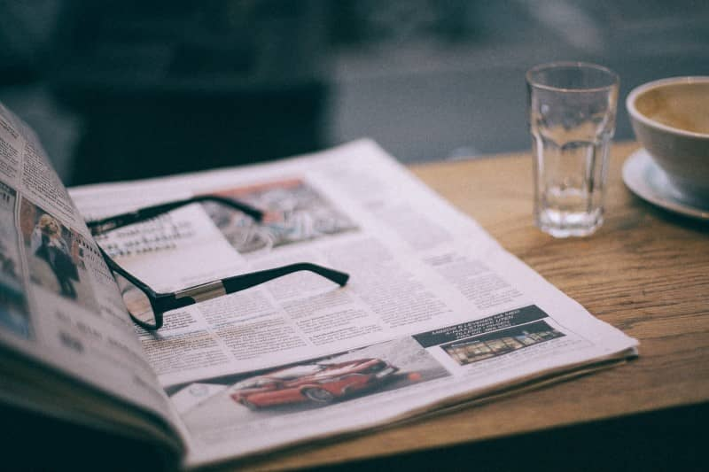 Open Newspaper With Glasses